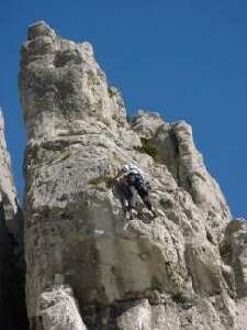 Climbing one of the routes on La Baume rock at Sisteron